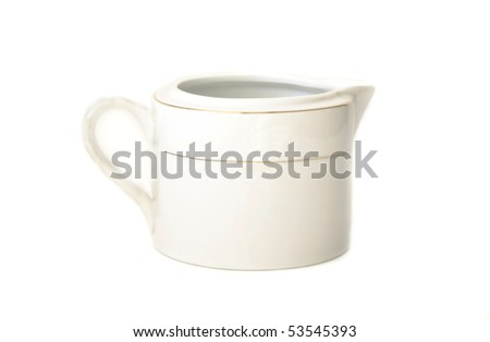 White milk jug with a gold pattern