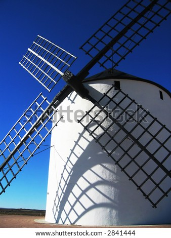 White mill in a sunny day with a blue sky