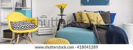 White modern bedroom with yellow and turquoise decorations - stock photo