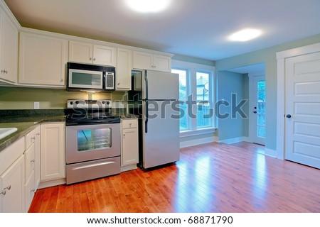 White modern empty kitchen with stainless still appliances. - stock photo