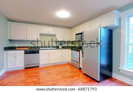White modern empty kitchen with stainless still appliances. - stock photo