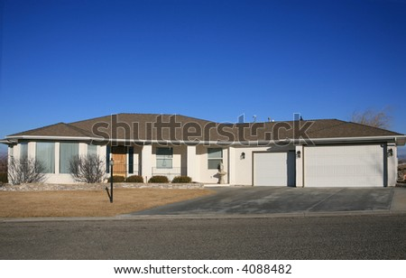 white modern house under deep blue sky