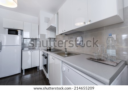 White, modern interior design: small kitchen in scandinavian style - stock photo