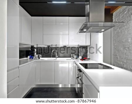 white modern kitchen with steel appliances - stock photo