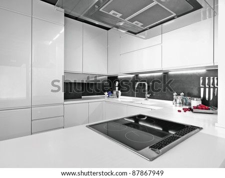 white modern kitchen with steel appliances - stock photo