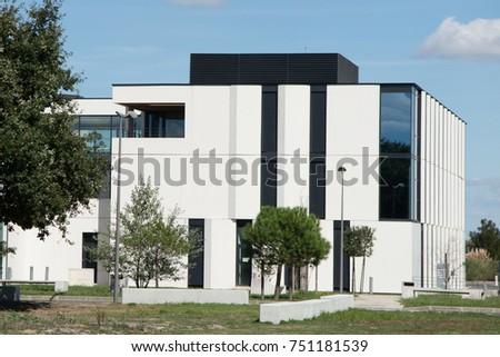 white modern Office building under a blue sky