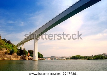 White modern railway bridge Ponte S. Joao(1991)  in Porto(Portugal). It is currently the seventh longest concrete bridge in the world. - stock photo