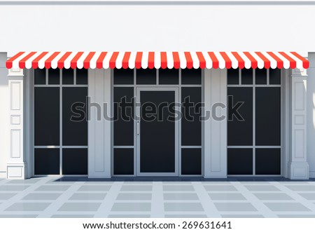 White modern shopfront in the sun - classic store front with red awnings - stock photo