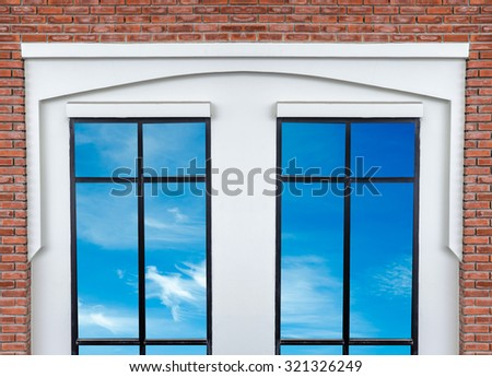 white modern window with brick wall background