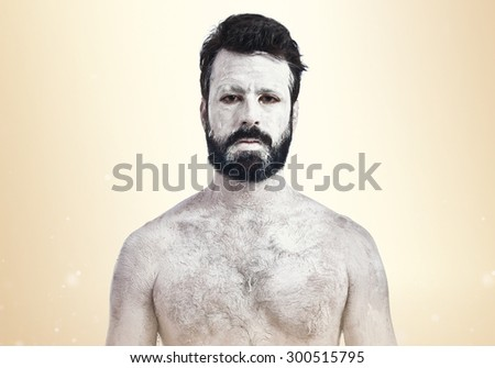 White monster over ocher background - stock photo