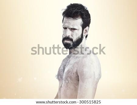White monster with beard over ocher background - stock photo