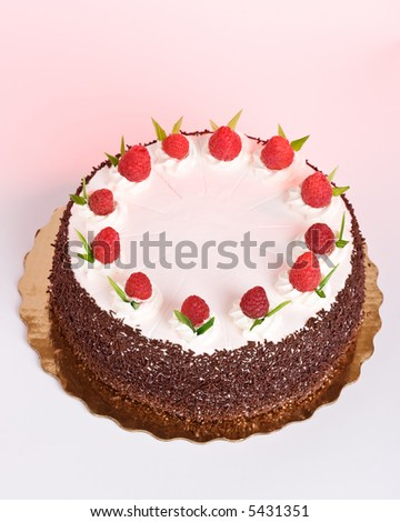 White moose cake with raspberries - stock photo