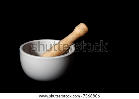 White mortar over solid black background - stock photo