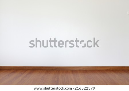 white mortar wall and wood floor in the room - stock photo