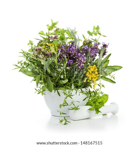 White mortar with blooming herbs on white background