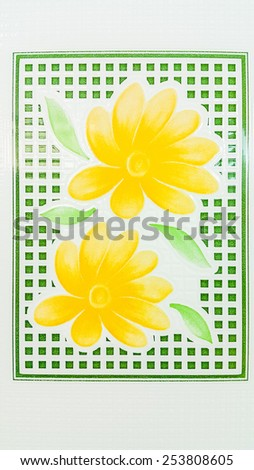 White mosaic with yellow flowers and green leaf - stock photo