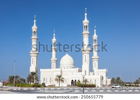 White mosque in Ajman, United Arab Emirates - stock photo