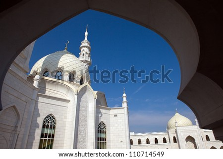 White Mosque in Ornamental opening - stock photo