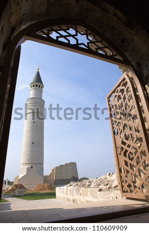 White mosque with two minarets on a background of blue sky - stock photo