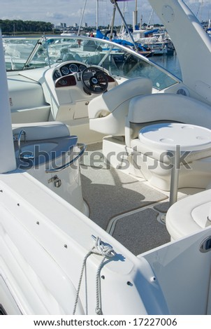 White motor boat in a Marina