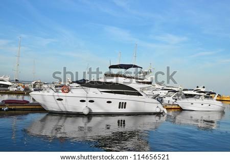 White motor yacht over harbor pier, Odessa, Ukraine - stock photo