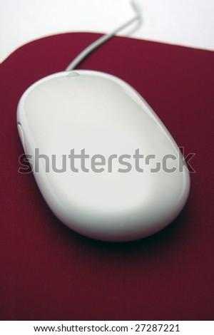 White mouse on a wine red mouse pad
