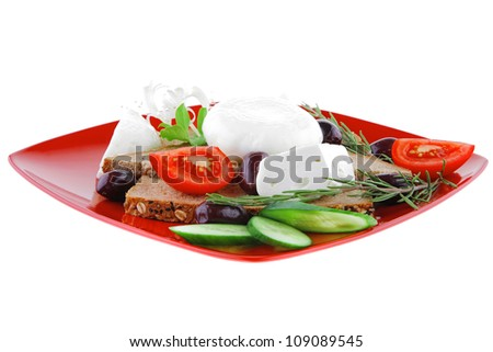 white mozzarella cheese on red plate with olives and tomatoes