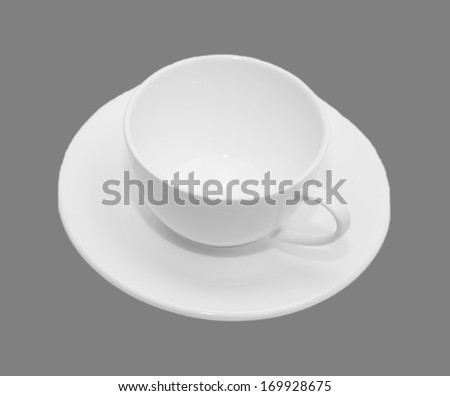 White mug and saucer on a gray background.