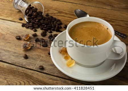 White mug of morning coffee. Cup of coffee and brown sugar. Strong coffee.  - stock photo