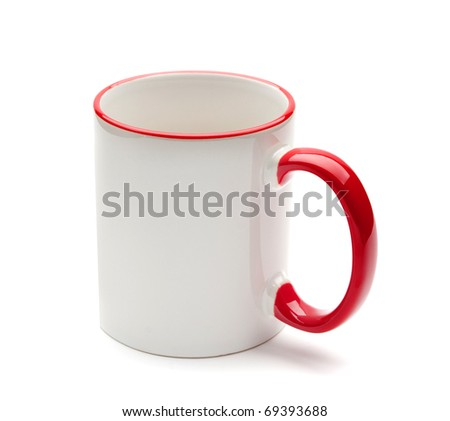white mug with red handle on a white background - stock photo