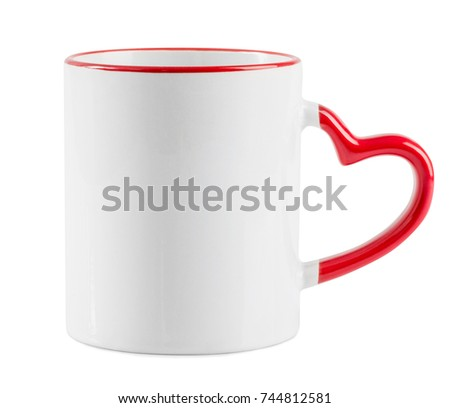 White mug with red heart shaped handle on a white background. White cup isolated on a white bachground.
