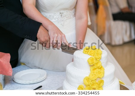 white multi level wedding cake with flower decorations