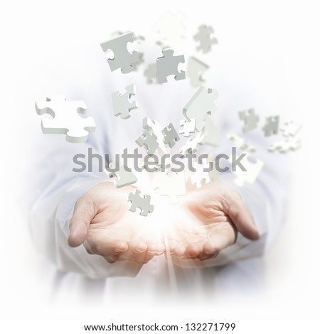 White multiple puzzle piece flying in different directions - stock photo