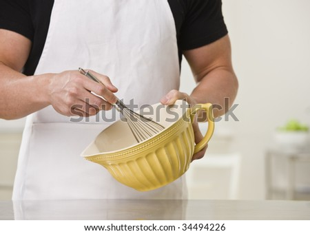 White muscular male with whisk and bowl. Horizontal. - stock photo
