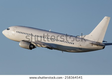 White narrow body airplane climbing into the sky - stock photo
