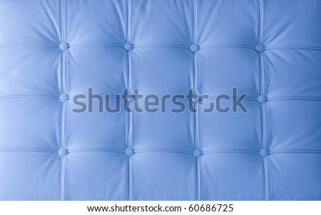 white natural leather upholstery of cushion on the modern chair - stock photo