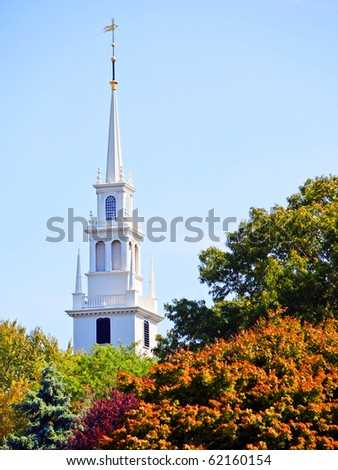 White new england style colonial church spire in fall - stock photo
