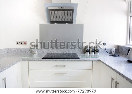 white new modern kitchen with hob and extractor fan - stock photo
