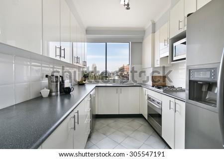 White new small simple classic kitchen interior. - stock photo
