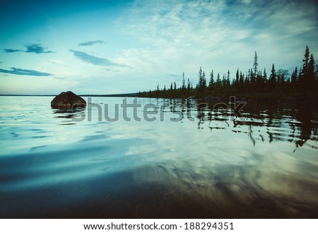 white nights of the north. One of the wild lakes - stock photo