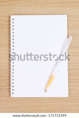 White Note Book Blank Page on Wood Table