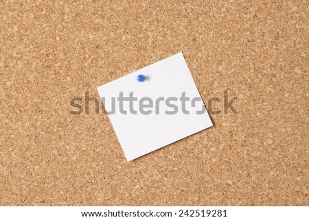 White note on cork-board