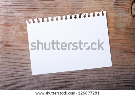 White note on wooden ground/note/paper