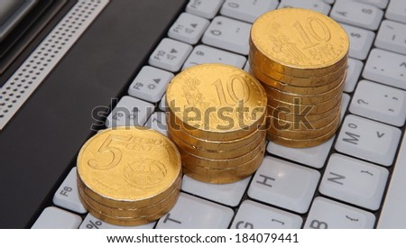 White Notebook keyboard and Gold Coins