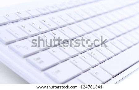 White notebook laptop - close up on a white background - stock photo