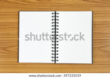white notebook on wood background