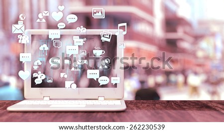 White notebook with social media related icons on a table and blurred city street in the background. Social media concept with vintage effect and space for text. - stock photo
