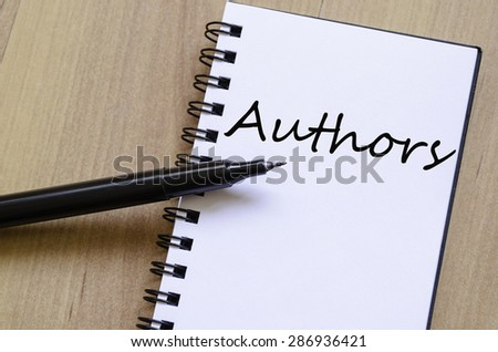 White notepad and ink pen on the wooden desk Authors concept - stock photo