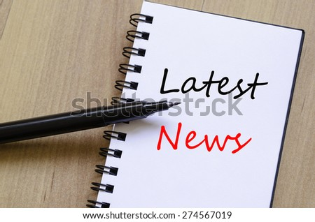 White notepad and ink pen on the wooden desk Latest news Concept - stock photo