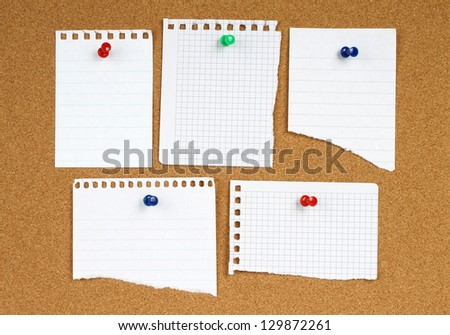 White notes with pin on wooden background - stock photo